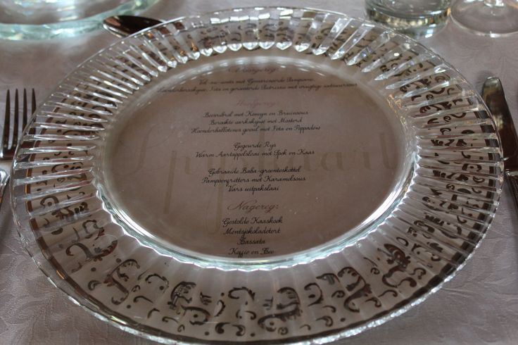 Menu's can spoil a table setting, but placing them under a glass base plate is the perfect finish to any table