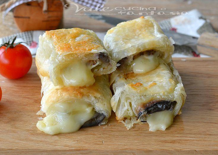 Involtini di sfoglia con melanzane e formaggio, sfiziosi stuzzichini di pasta sfoglia con un ripieno di melanzane e formaggio, golosi, appetitosi e facili
