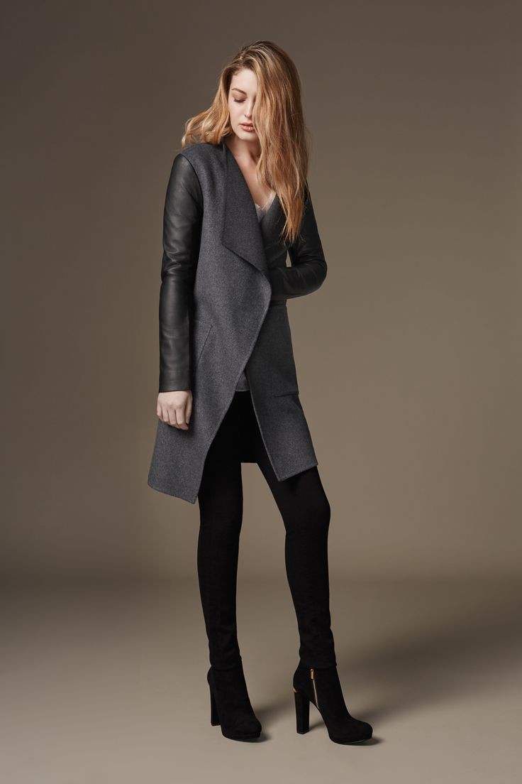 TISSIA is a straight fit, double face wool coat with large lapel collars and leather sleeves. Deep patch pockets complete this minimal, modern look. Discover at http://www.soiakyo.com/ca/en/tissia-double-face-wool-jacket-in-charcoal-for-women