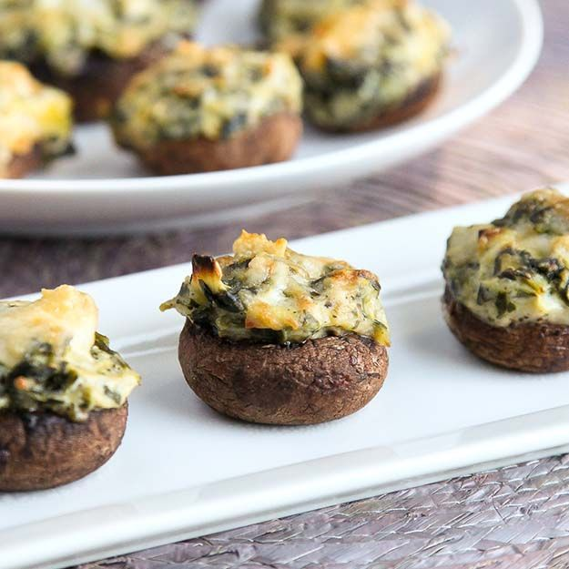 Spinach Artichoke Dip Stuffed Mushrooms one of DIYReady.com favorite finger foods for your party. Check them all out at diyready.com/easy-finger-foods-recipes-and-ideas-for-your-party/