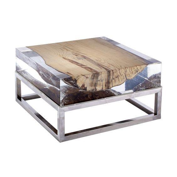 Mesa de centro feita com tronco envolto em acrílico...