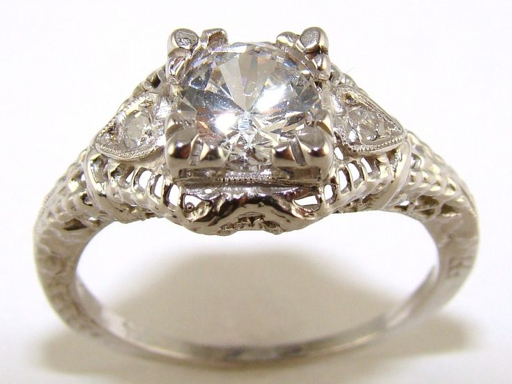 Antique style ring with diamond sidestones $549