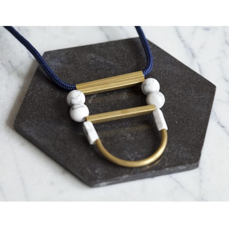 The Adorn Collective FORM Arc necklace. Handmade to order using marble stones, brass fixtures and Japanese paracord. Order now at www.theadorncollective.com.au/products/tac-form-marble-arc-necklace #handmade #necklace #jewellery #fashion #style #theadorncollective