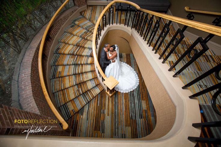 Symmetry + Candid wedding photo + Staircase. by Moussa Faddoul www.fotoreflection.com