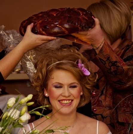 A common Romanian tradition is that at weddings, the bride will have a homemade loaf of bread broke on top of her head to give her good fortune in the marriage.