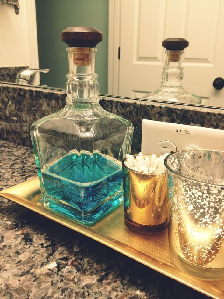 Jack Daniels bottle recycled as a mouthwash holder, much prettier than plastic bottle. | Home Decor In Your Life