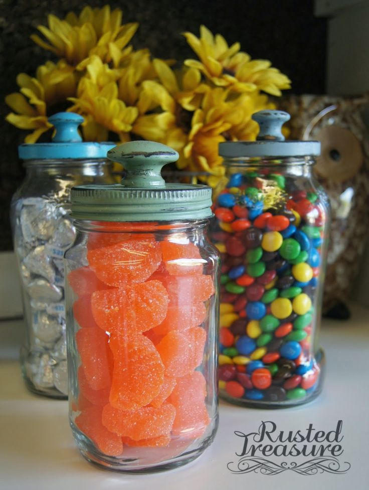 painted and distressed blue and green spaghetti jars made into candy jars filled with candy