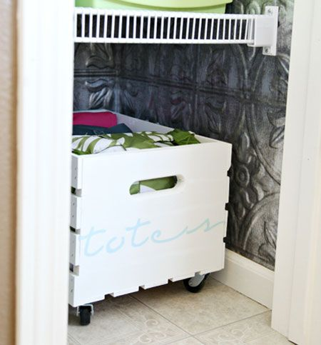 Painting this wooden crate and adding some wheels created a simple storage solution to keep items off the floor.