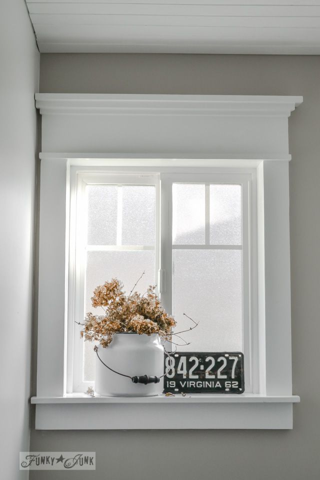 Make a farmhouse window - add window trim to beef up a plain window with no miter cuts in sight! via http://www.funkyjunkinteriors.net/