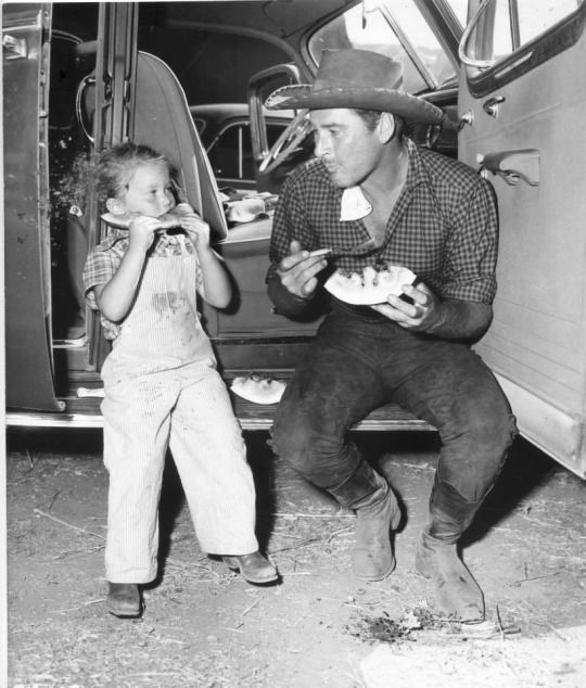 Errol Flynn and his daughter, Deirdre.