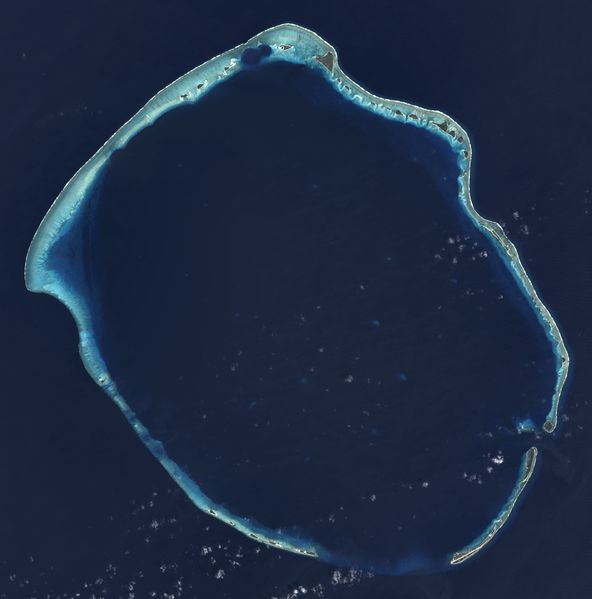 Landsat 8 satellite image of Enewetak Atoll. The crater formed by the Ivy Mike nuclear test can be seen near the north cape of the atoll, with the smaller Castle Nectar crater adjoining it.