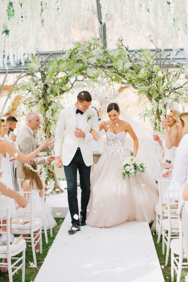 Elegant wedding between MaRina and  Wojciech Szczęsny: Groom's Attire: Tom Ford - http://www.stylemepretty.com/portfolio/tom-ford Wedding Dress: Mira Zwillinger - http://www.mirazwillinger.com Ceremony Venue: Vouliagmeni Lake - http://www.stylemepretty.com/portfolio/vouliagmeni-lake   Read More on SMP: http://www.stylemepretty.com/2016/11/07/this-greek-wedding-is-total-floral-goals/