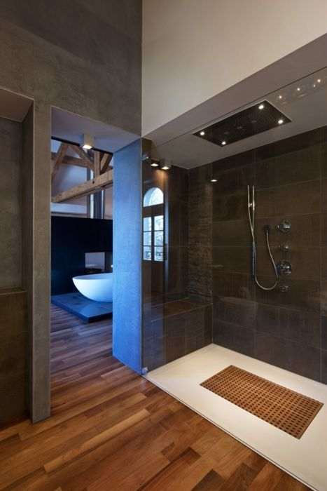 modern walk-in shower Like the Teak floor mat in the shower and the wood floor outside.