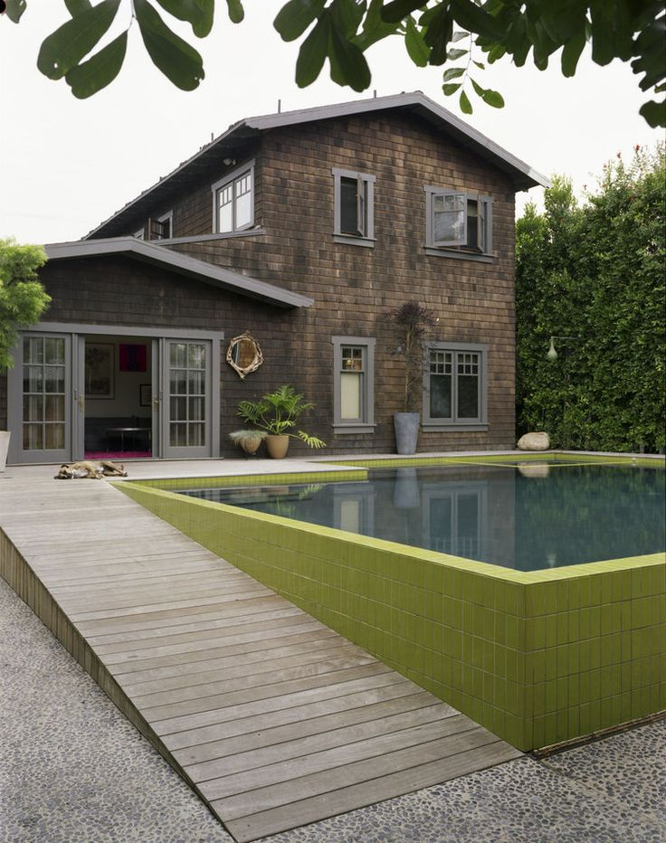 Modern pool house with seeded concrete walkway