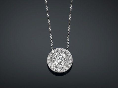 Subtle sophistication is the hallmark of this exquisite diamond pendant necklace ~ M.S. Rau Antiques