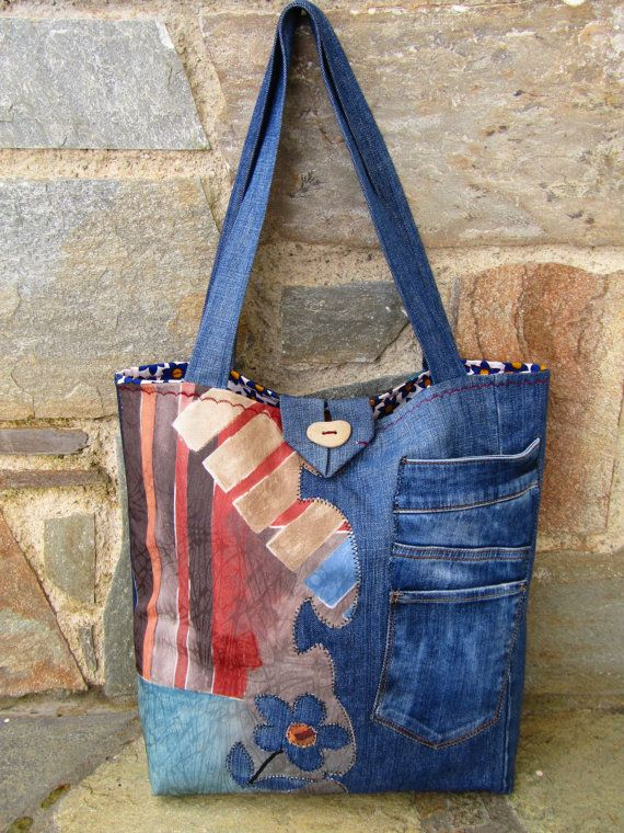 A unique, one of the kind, handmade tote bag! Upcycled jean and upholstery fabric are the main materials of this beautiful bag! Its lined with a More