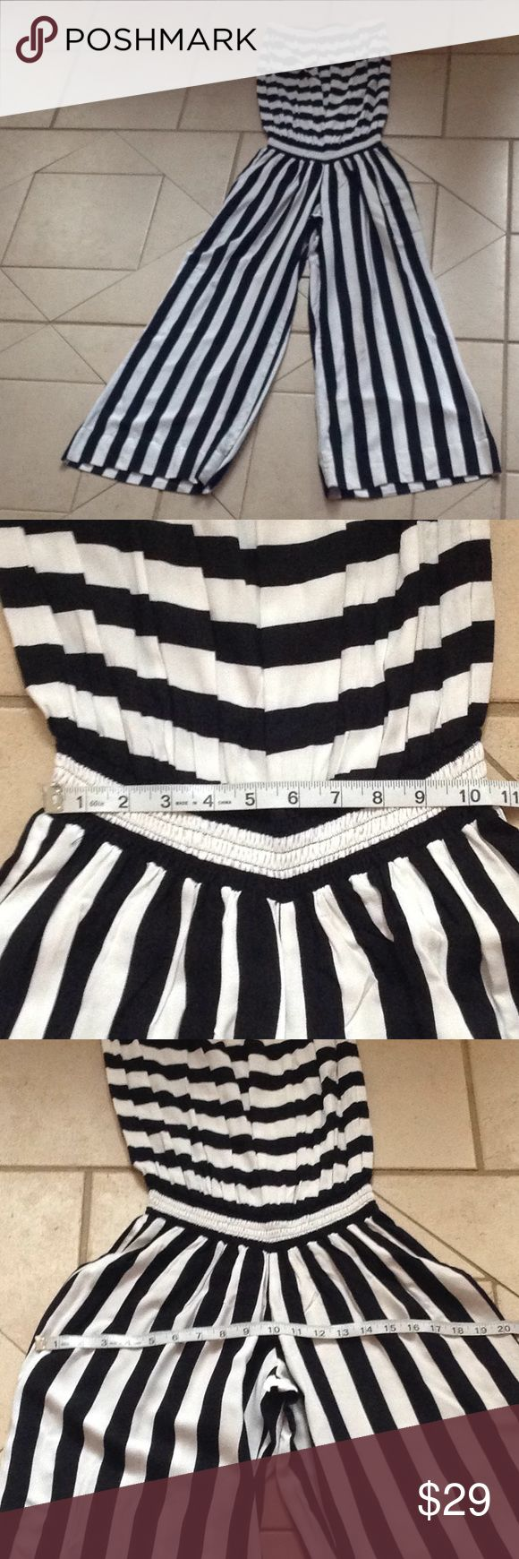 COOLCHANGE Jumpsuit.    Sz SM GREAT BUY! Describes this Black/White Strapless COOLCHANGE Jumpsuit that measures 10 1/2 inches across the Elasticized waist; is 20 inches across the hips; has a 29 inch inseam; and is 56 inches in overall length. coolchange Pants Jumpsuits & Rompers