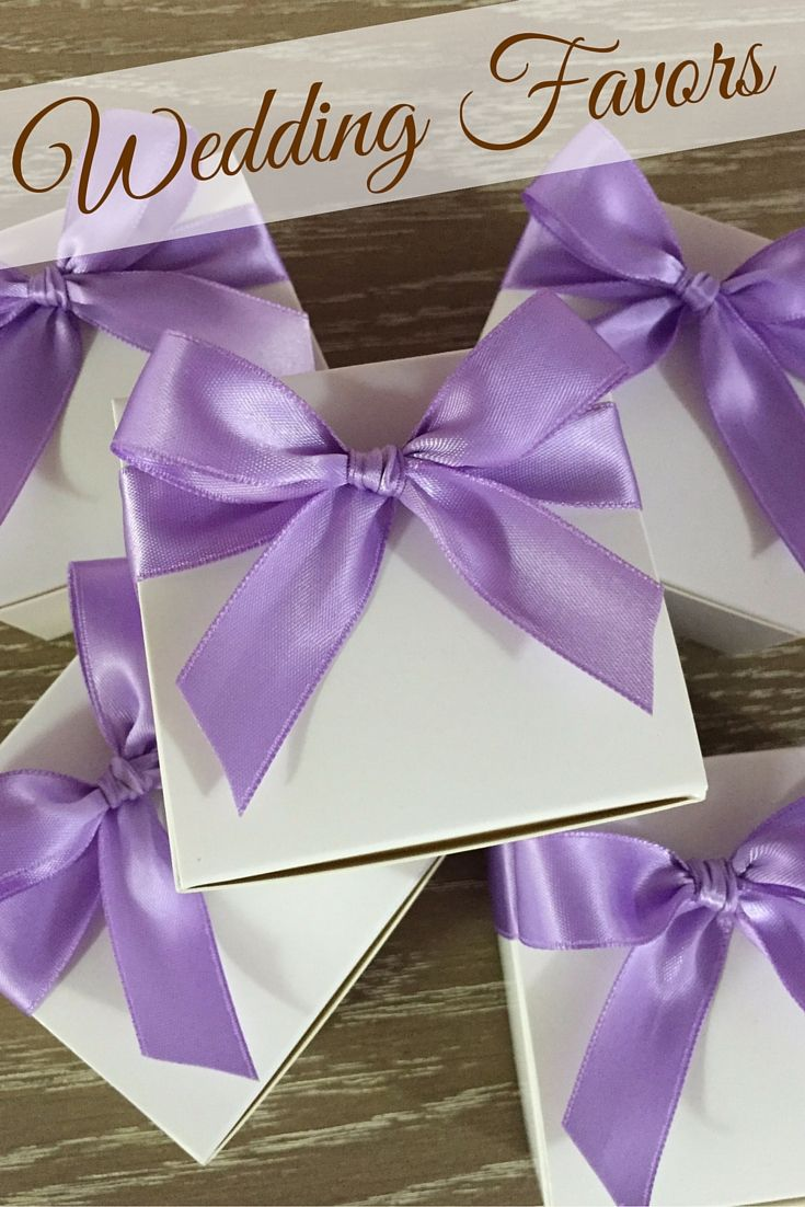 Lavender and white wedding favors! These cute gift boxes hold 4 individually wrapped caramels.