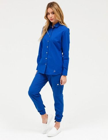 Jaanuu Tulip Top // Stylish Scrubs An essential for any cold healthcare setting, this ultrasoft collared button-front shirt is seamlessly tailored with back darts to accentuate the slightly drapey silhouette. Two side entry pockets provide the functionality needed for the power healthcare woman.
