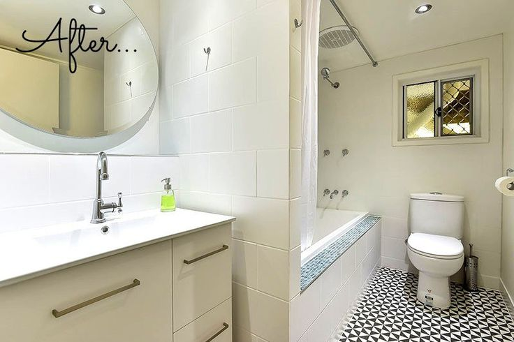 Studio apartment bathroom with shower over bath and black and white terrades floor tiles.