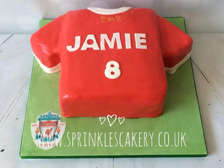 A Liverpool FC T-shirt cake personalised with the birthday boys name and age. A spot of in-house edible printing of the team badge then finishes off the board.