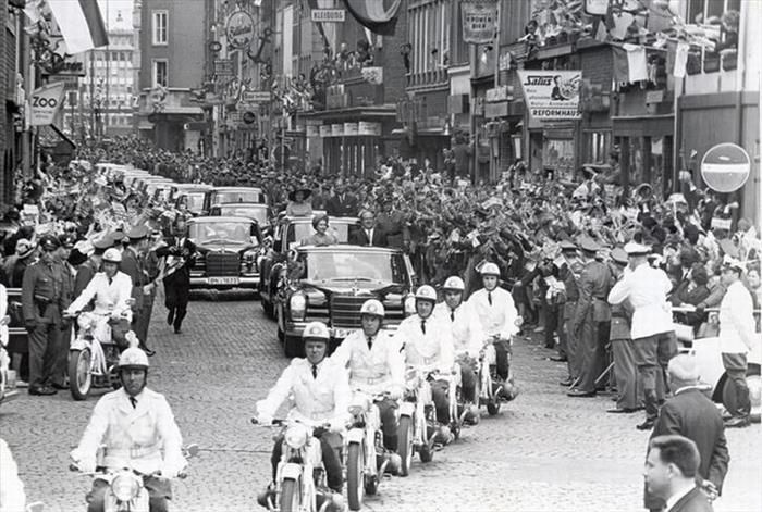 The welcome parade for Queen Elizabeth's first official visit to Germany in 1965. Notice standing in car so they could be seen.