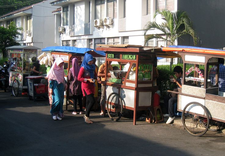 Kakilima (lit. five feet) street vendor carts in Jakarta, Indonesia, selling Indonesian typical dishes such as chicken satay, soto, gado-gado, and es teler.