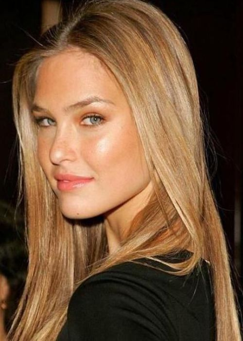 bar rafaeli {blond hair color} Israeli fashion model Bar Refaeli looks simply stunning with her poker-straight caramel blonde locks. Caramel blonde is a deliciously warm hair colour that can soften any complexion. Add some golden undertones for a beautiful, shimmery finishing touch.