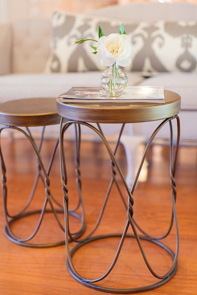 Two small stools work just as well for a coffee table in cramped quarters