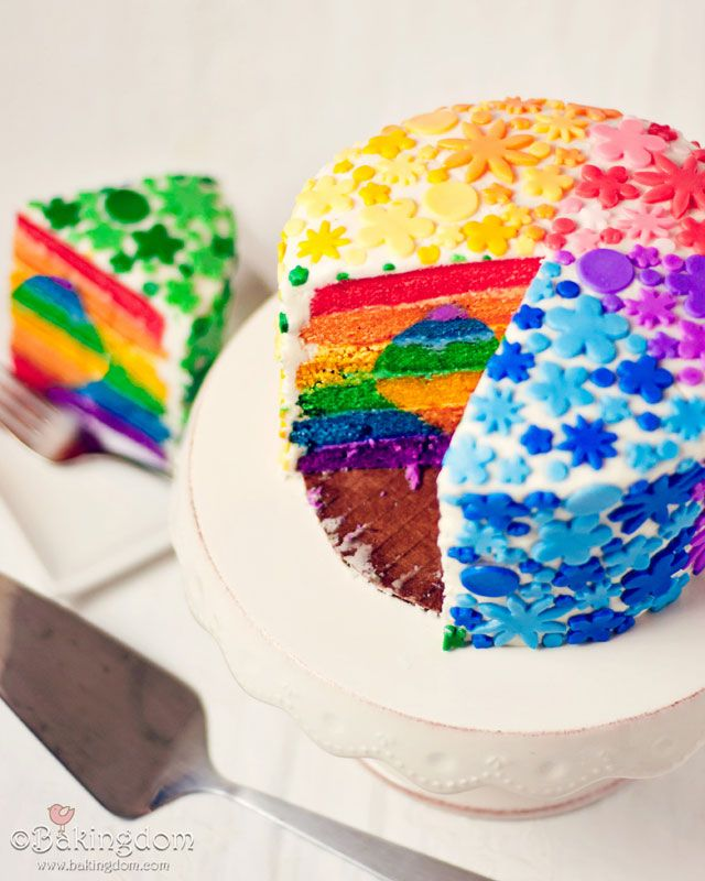 the ultimate rainbow cake with a heart in the center