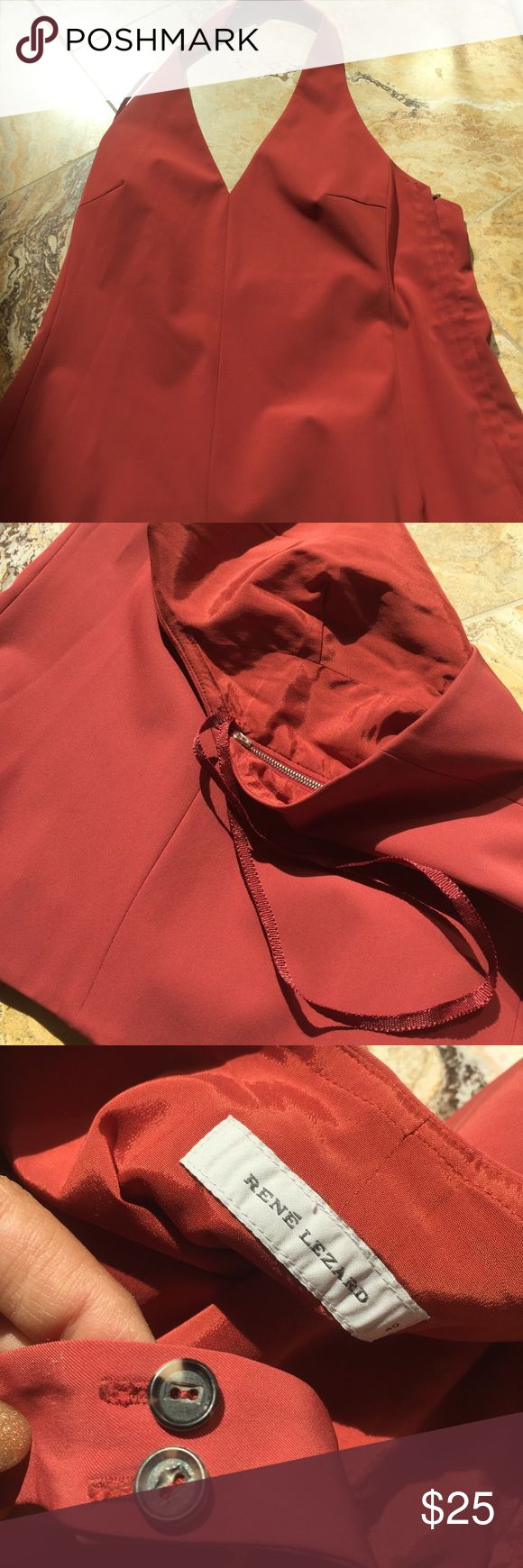 Rene Lezard rust hue lined halter w/zipper&buttons Classic styling halter with button top and zipper entry and gorgeous rust color. Made with polyester and spandex, fully lined & has hanger strip hooks René Lezard Tops