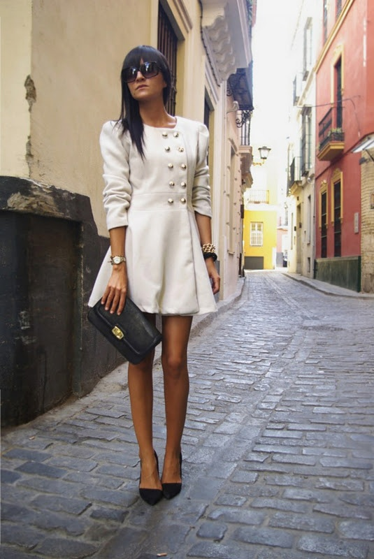 stunning white coat with black accessories