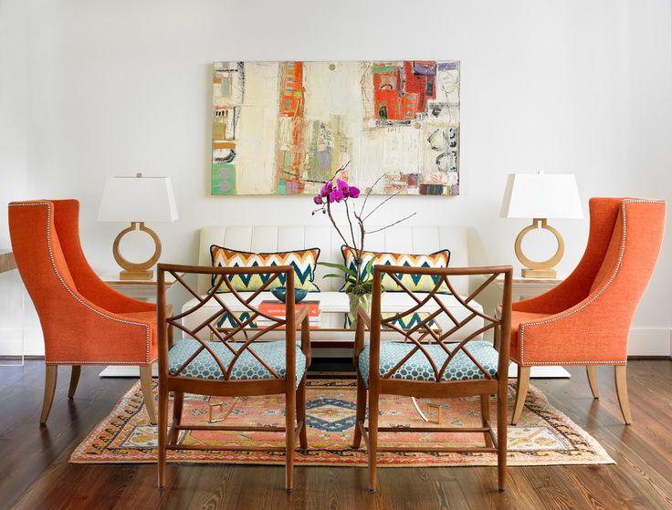 Transitional living room with pops of orange - Decoist