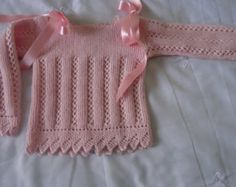 Baby sweater - sideways garter, lace ridges & lace sawtooth edging