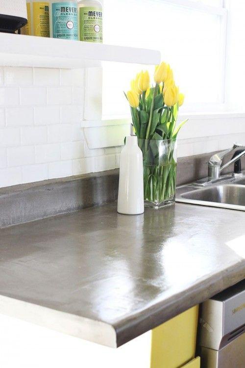 http://www.shelterness.com/8-minimalist-diy-concrete-countertops/