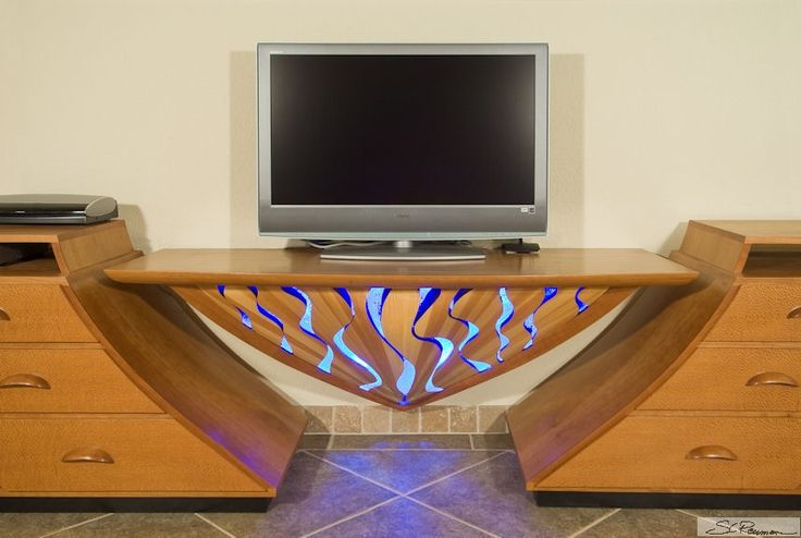 Custom Made AV and Entertainment Centers, for home theaters, large screen TVs, beautiful furniture for any room or office. By Scott Reuman, Conundrum Designs Inc.