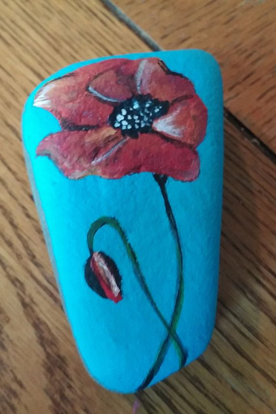 This is a lovely, little, hand painted poppy on a river rock.  It is approximately 3x2. I love finding little rocks and stones and imagining