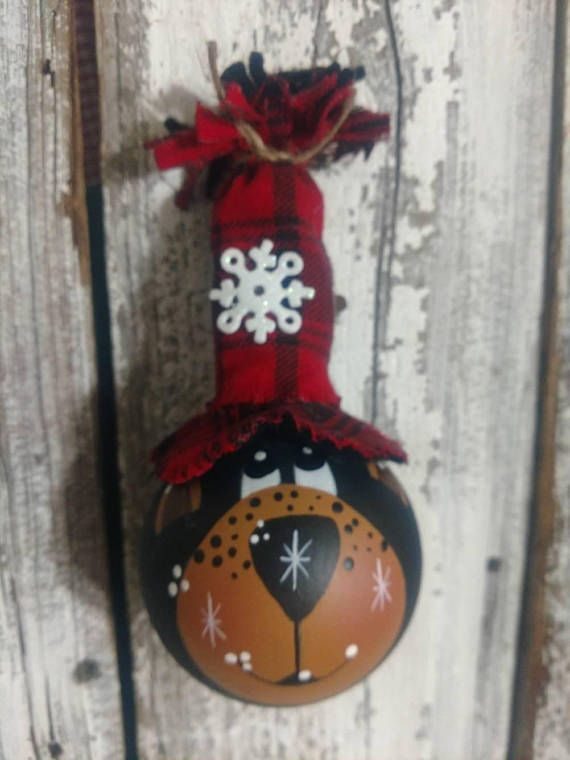 A hand painted Christmas ornament. A lightbulb made to look like a bear. The tall red and black hat is also hand made. These are made from the globe type lightbulbs. Please keep in mind that no two are identical. He is $11.50 plus shipping.