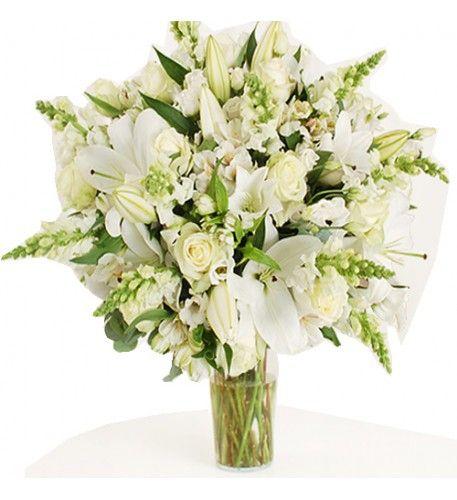 This arrangement contains the following flowers: 10 x White Antirrhinum 15 x Dutch White Roses 10 x White Lisianthus 8 x White Oriental Lilies 12 x White Alstroemeria 2 x Bunches of Eucalyptus.