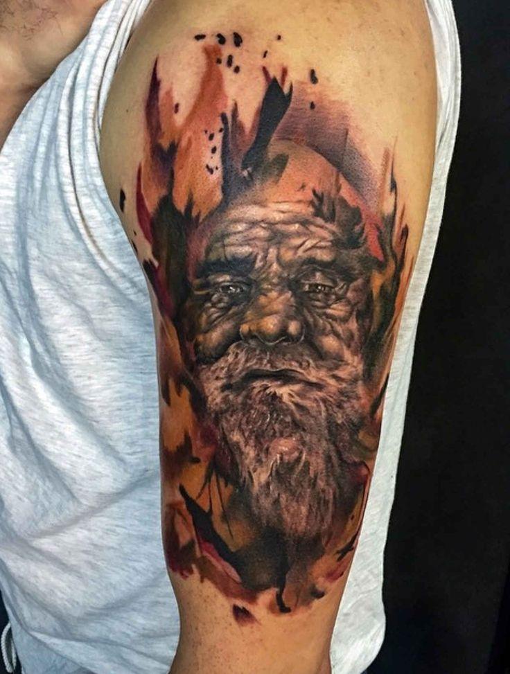 Male arm tattoo by Mor Mogli Cohen.
