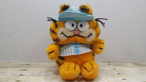 Cute little Garfield baseball player. Minimal wear, the baseball hat could use a run in the washing machine, but it would need to be snipped