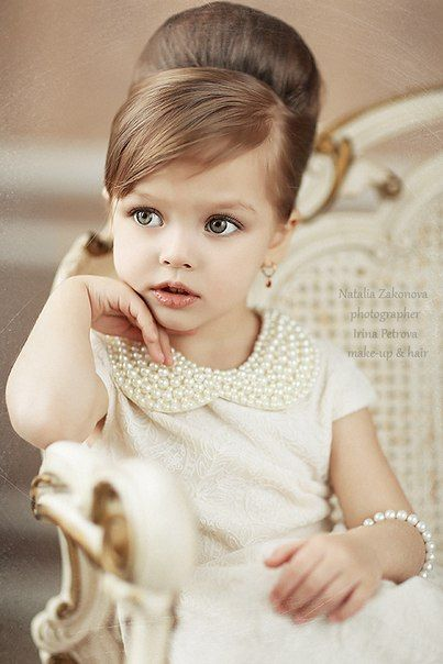 This petite mademoiselle is pretty in pearls and ready for flower girl duty.