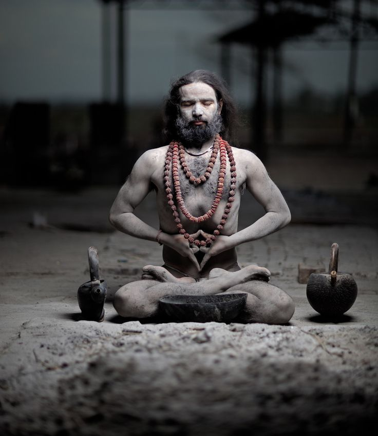 A Yogi master covered in human ashes practices the Meditation of the Dead. inbalanceee
