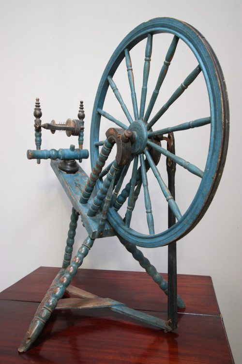 A number of antique spinning wheels were painted light blue. I kind of like the look.