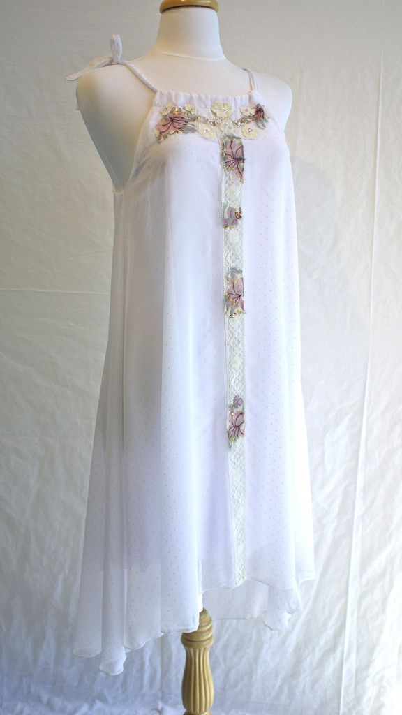 For the forest fairy bride, this sheer chiffon dress is embellished with antique lace, and hand sewn sequins and beads. It is longer in the back and the straps are adjustable.