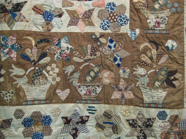 Details of English basket quilt. This is one of the quilts I would love to make, love the different baskets.