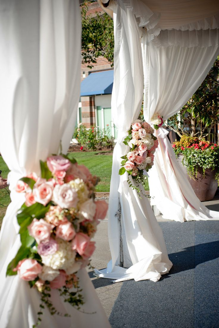 Beautiful floral arrangements are a perfect way to add flair and romance to a simple tent. -Coronado Island Marriott Resort  Spa