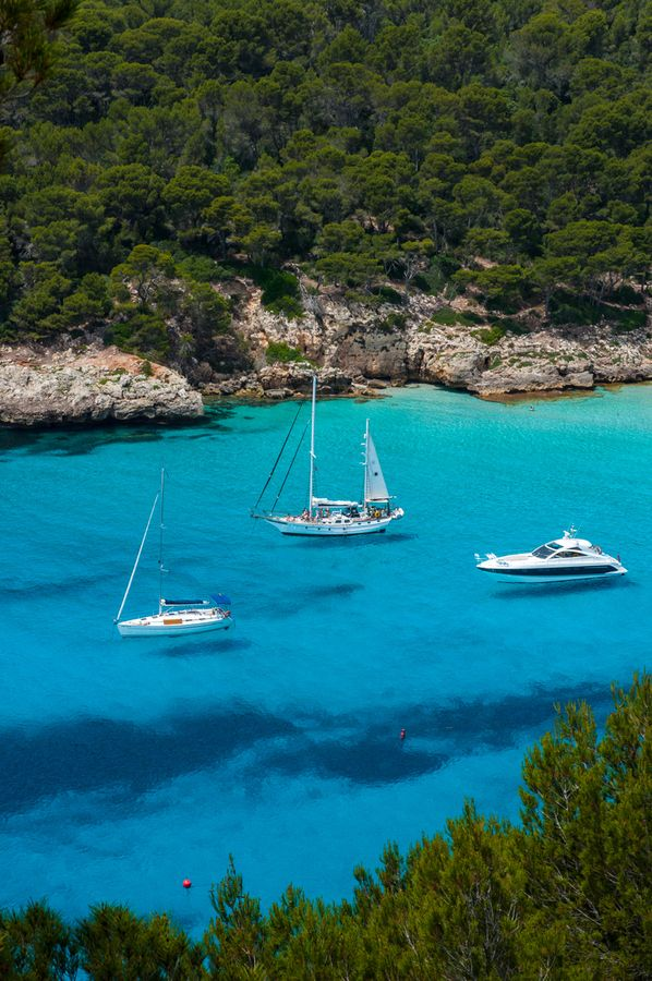 Menorca. The water is so clear, it looks like the boats are floating!