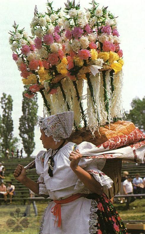 Godmother carries the wedding radostník (cake), Slovakia.