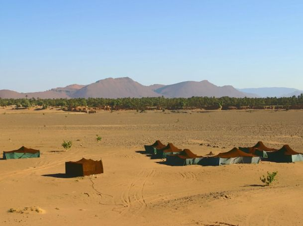 2 days & 1 night desert tour from Marrakech: Morocco tour from Marrakech to Zagora desert through the high atlas mounatains and Ait benhadou Kasbahs and driving ahead to Draa valley with its palm grove to get to Zagora and riding camels to reach the camp.